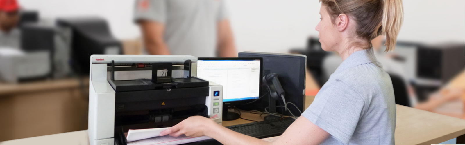 Records management staff scanning documents